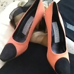 New black and orange suede heels